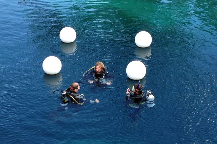 The swimming hole is a popular location for scuba training because of its clear waters. Here, some divers are seen last summe
