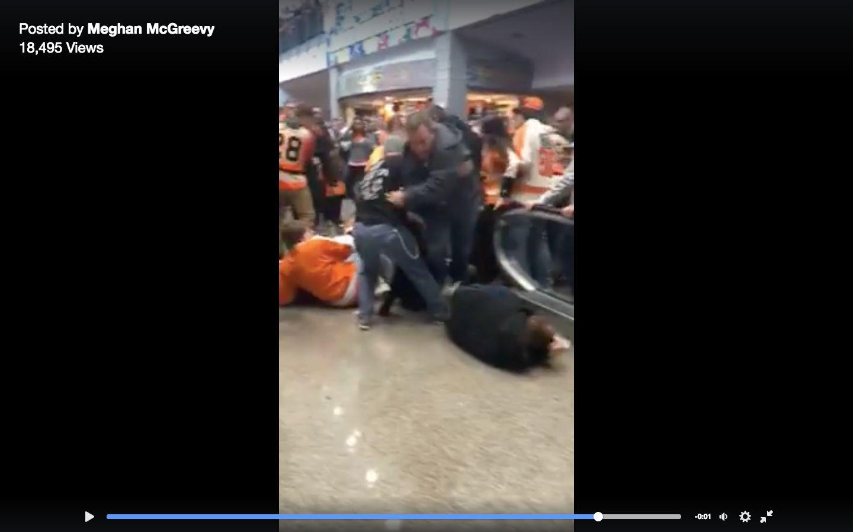 Philadelphia Flyers fans were seen being thrown off an escalator after being the Ottawa Senators on Saturday.