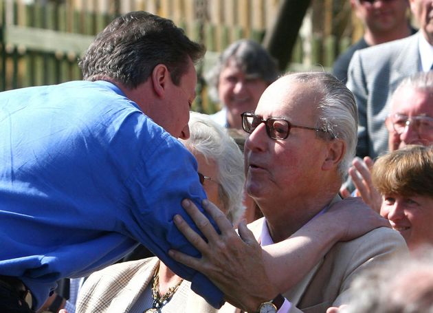 David Cameron (left) greeting his father Ian (right) during the 2010 General Election
