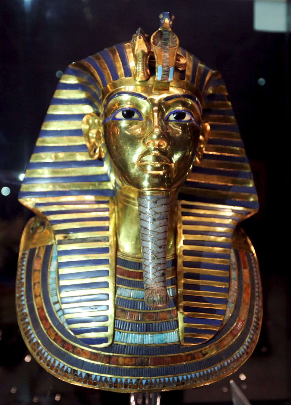 The golden mask of King Tutankhamun is displayed inside a glass cabinet at the Egyptian Museum in Cairo,