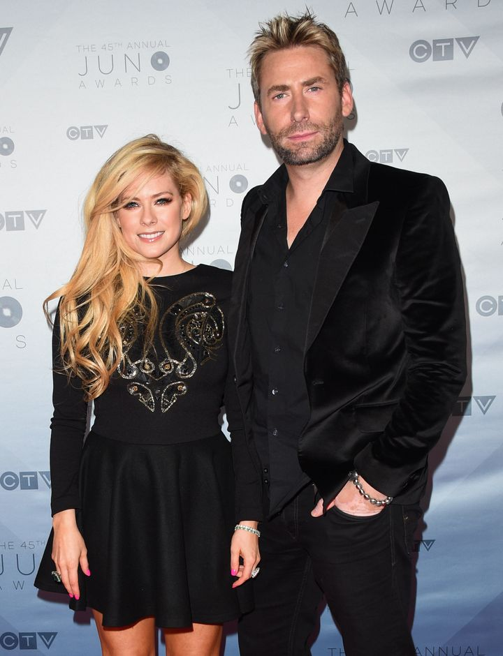 Recording artists Avril Lavigne and Chad Kroeger arrive at the 2016 Juno Awards at Scotiabank Saddledome on April 3, 2016, in