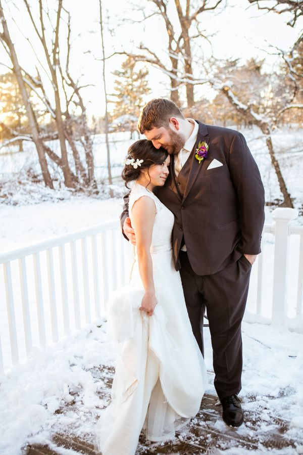 """""""Xuan and TJ were married on April 2 in Grand Rapids, Michigan. We were surprised with a snowstorm on their lovely day. Once"""
