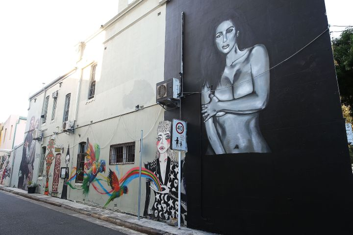 A view of the mural after it was damaged by spray paint and subsequently covered up with black paint.