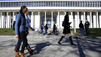 People walk past Princeton University's Woodrow Wilson School of Public and International Affairs in Princeton, New Jersey, November 20, 2015. Princeton University has pledged to consider renaming buildings dedicated to former U.S. President Woodrow Wilson, the latest U.S. campus effort to quell student complaints of racism. REUTERS/Dominick Reuter