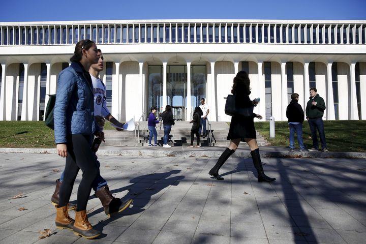 People walk past Princeton University's Woodrow Wilson School of Public and International Affairs in Princeton, New Jersey, N