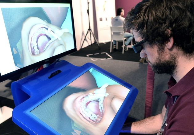 Students can use virtual reality scenarios, like this dental care simulator, to practice medical