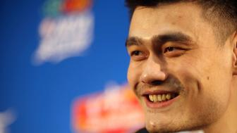 BEIJING - OCTOBER 13:  (CHINA OUT) Yao Ming of Houston Rockets talks to the media during a press conference after the 2010 NBA China Games between New Jersey Nets and Houston Rockets at the Wukesong Arena on October 13, 2010 in Beijing, China.  (Photo by ChinaFotoPress/Getty Images)