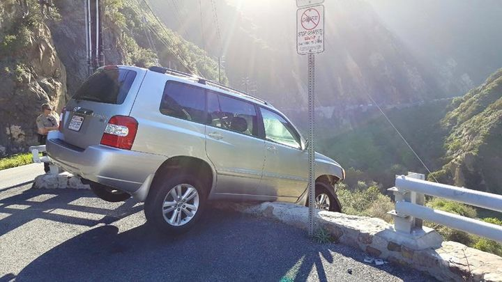 A man who survived nearly driving his car off a California cliff was struck by a passing tour bus moments later, authorities