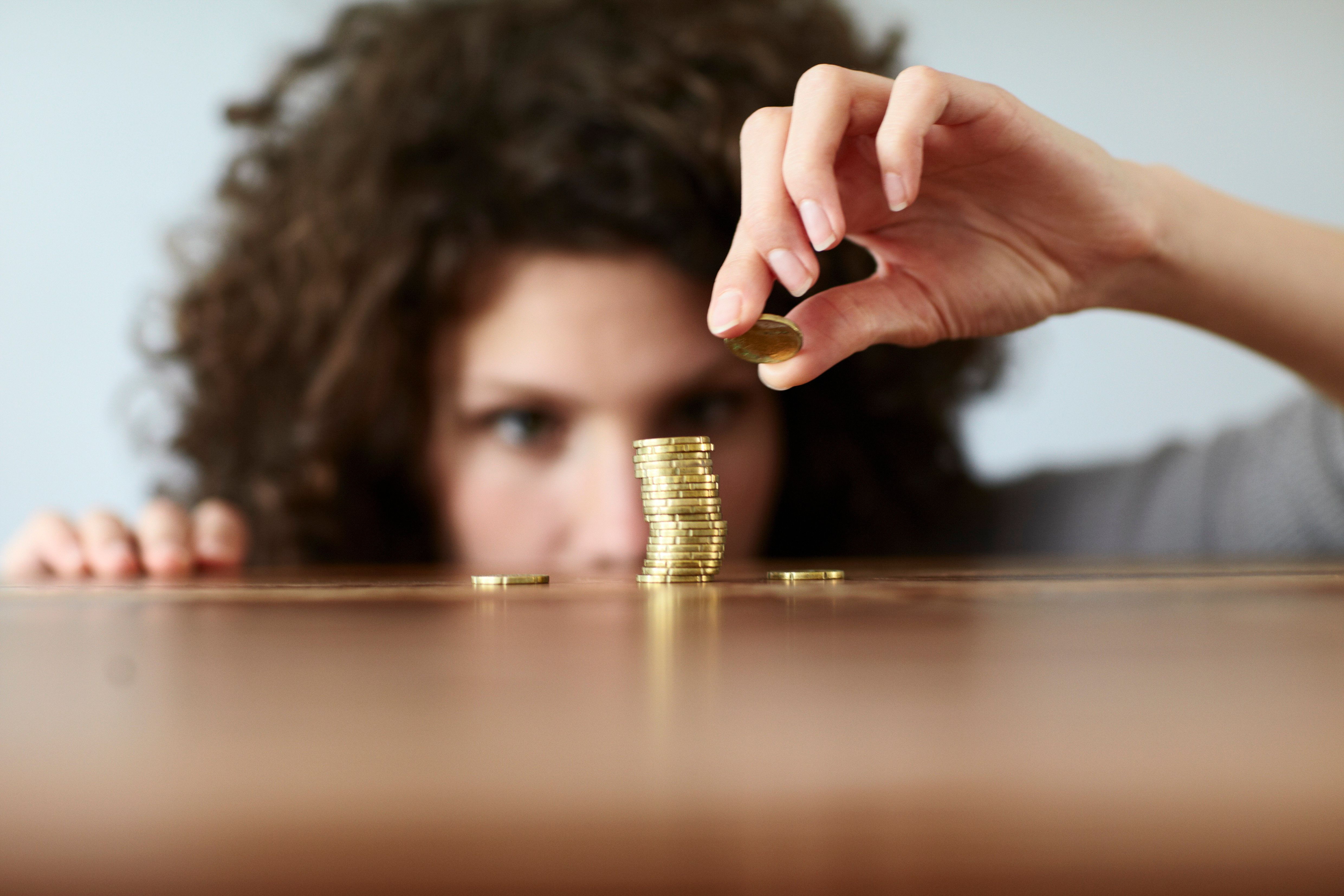 young woman with pile of coins