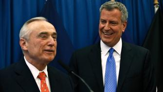 New York Mayor-elect Bill de Blasio (R) smiles as he listens to veteran police chief Bill Bratton during a news conference in Brooklyn, New York, December 5, 2013. Bratton who has led departments across the country, was named on Thursday as New York City's next police commissioner, taking over a force credited with a sharp drop in violent crime but criticized for its tactics. REUTERS/Eduardo Munoz (UNITED STATES - Tags: POLITICS CRIME LAW)