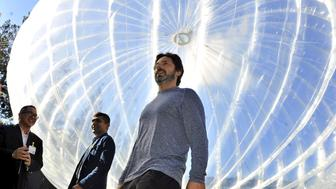 "Google co-founder Sergey Brin (R) walks in front of a giant balloon to show ""Project Loon"" to Indonesian delegates at the Google office in Mountain View, California, October 28, 2015 in this picture taken by Antara Foto. Alphabet Inc, the new holding company for Google, has teamed up with three Indonesian telecommunications companies to expand Internet access in that country using solar-powered balloons. Picture taken October 28, 2015. REUTERS/Yudhi Mahatma/Antara FotoATTENTION EDITORS - THIS IMAGE HAS BEEN SUPPLIED BY A THIRD PARTY. IT IS DISTRIBUTED, EXACTLY AS RECEIVED BY REUTERS, AS A SERVICE TO CLIENTS. FOR EDITORIAL USE ONLY. NOT FOR SALE FOR MARKETING OR ADVERTISING CAMPAIGNS. MANDATORY CREDIT. INDONESIA OUT. NO COMMERCIAL OR EDITORIAL SALES IN INDONESIA.      TPX IMAGES OF THE DAY"