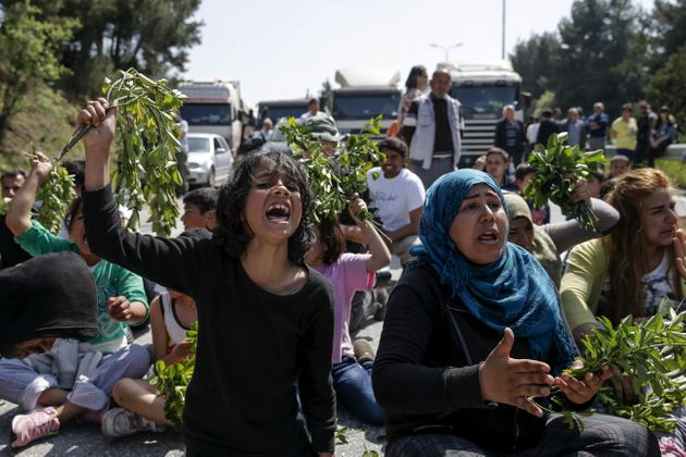 The first groups of migrants who are being sent back to Turkey under a controversial deal between Istanbul...