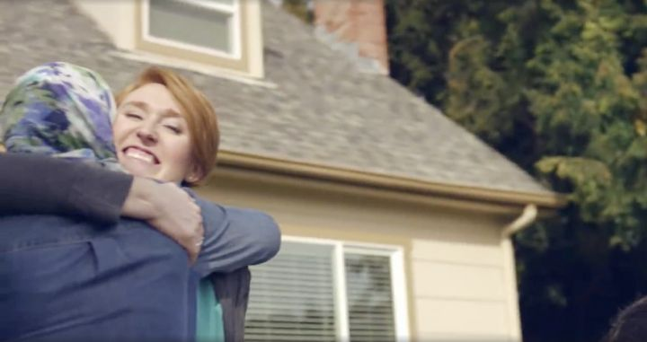 Two women are seen embracing outside of their homes in Honey Maid's latest ad, which is focused on cultural diversity and acc