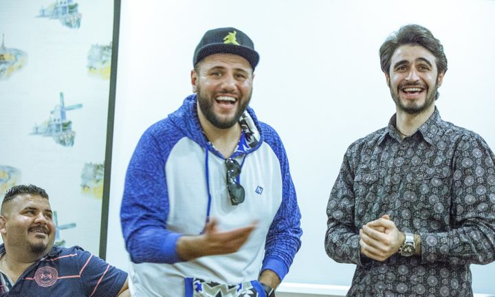 Iraqi creatives laugh during the workshop.