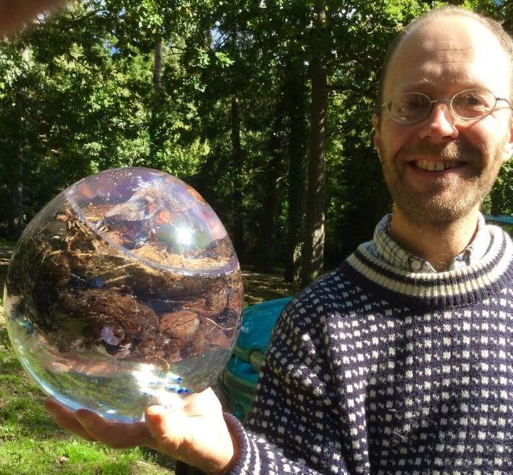 Dan Roberts, a curator for the National Poo Museum, holds a resin-encapsulated horse poo ready for display.