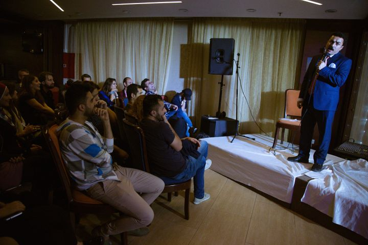 An Iraqi comedian performs a skit during a weekend workshop in Erbil that brought together dozens of Iraqi writers,
