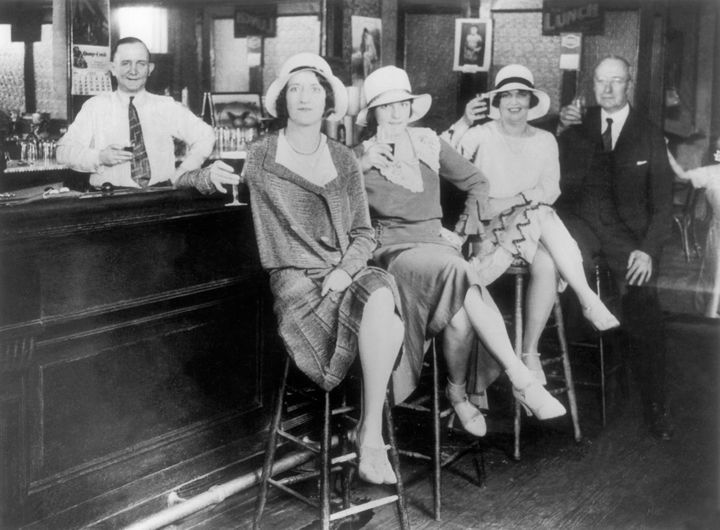 """If Prohibition taught usanything, it's that drinkers will always find a way to drink. Here, a group of rebels drink at an illegal New York """"speakeasy"""" in 1932."""