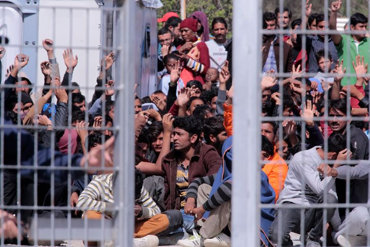 Migrants and refugees protest at a detention center in Lesbos, Greece. Turkey is ready to take another 200 migrants deported