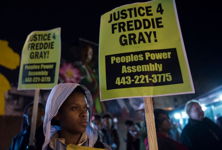 Residents demonstrate in reaction to a mistrial declared in the trial of police officer William Porter in Baltimore, Maryland