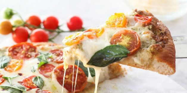 "Get the <a href=""http://www.foodiecrush.com/2014/08/pesto-pizza-with-fresh-tomatoes-and-mozzarella-and-perfect-pizza-at-home/"" target=""_blank"">Pesto Pizza with Fresh Tomatoes and Mozzarella recipe</a> from Foodie Crush<strong>.</strong>"