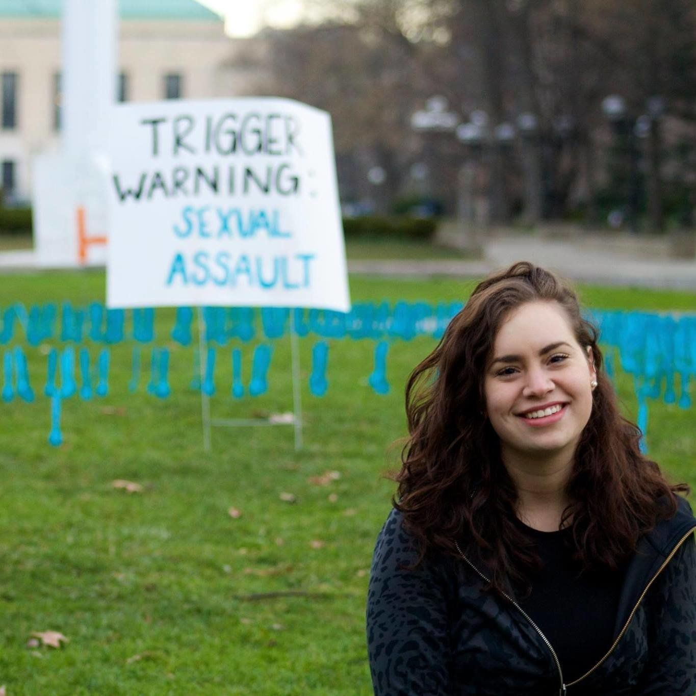Fabiana Diaz poses next to a sexual assault awareness placard from a demonstration she organized at the University of Mi