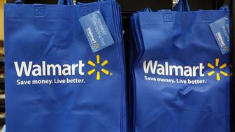 Re-useable Walmart bags are seen in a newly opened Walmart Neighborhood Market in Chicago September 21, 2011. The 27,000 square foot (2,508 square meters) store is the first in Illinois with an emphasis on groceries and basic household goods.  REUTERS/Jim Young      (UNITED STATES - Tags: FOOD BUSINESS)