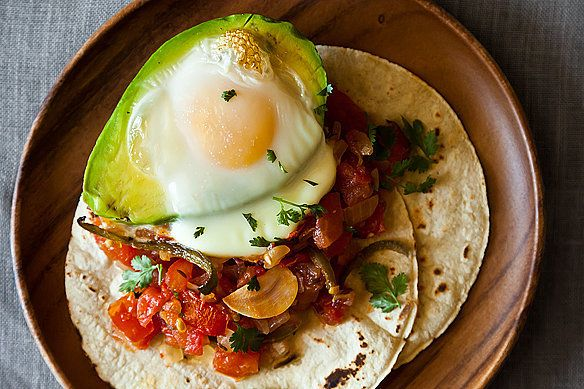 "Get the <a href=""http://food52.com/recipes/17998-avocado-y-huevos-caliente"" target=""_blank"" data-beacon=""{""p"":{""mnid"":""entry_text"",""lnid"":""citation"",""mpid"":26}}"">Avocado y huevos caliente recipe</a> from Angela @ the well-worn apron via Food52."