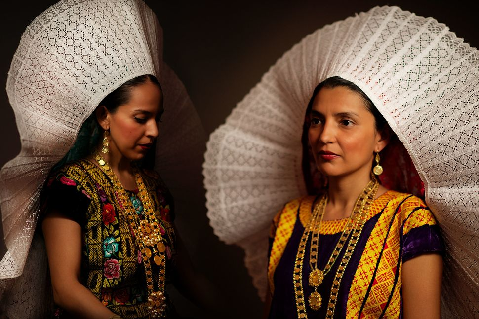 Tehuana women wearing their traditional headdress. The Tehuana-style of clothes was popularized by Mexican icon Frida Ka