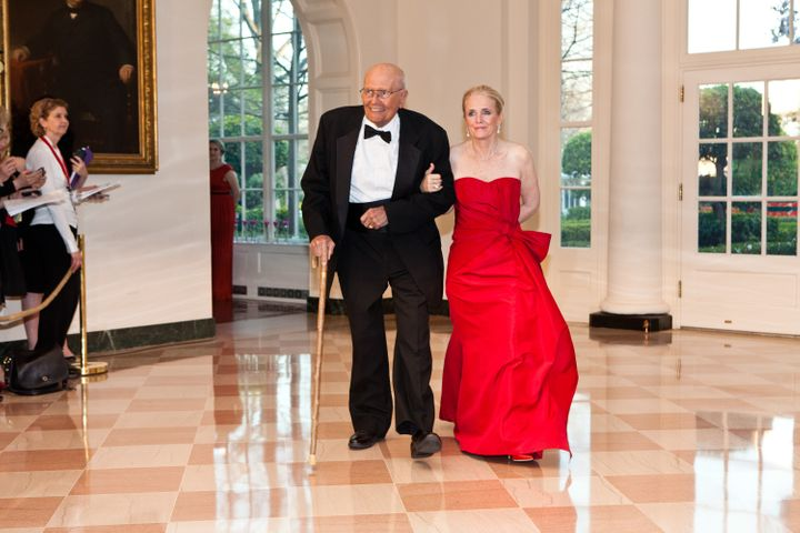 John and Debbie Dingell arrive for a state dinner at the White House in honor of British Prime Minister David Camer