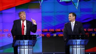 Republican presidential candidate, businessman Donald Trump speaks, as Republican presidential candidate, Sen. Ted Cruz, R-Texas, listens, during the Republican presidential debate sponsored by CNN, Salem Media Group and the Washington Times at the University of Miami, Thursday, March 10, 2016, in Coral Gables, Fla. (AP Photo/Wilfredo Lee)