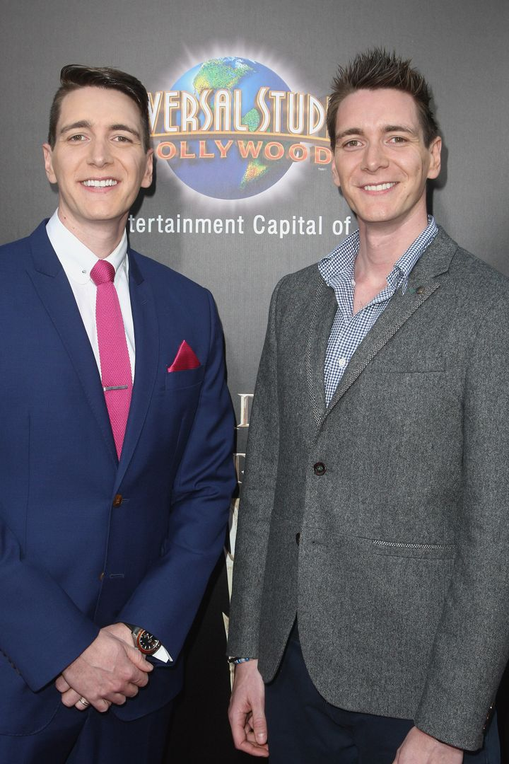 Actors Oliver Phelps (L) and James Phelps attend the Universal Studios Hollywood Hosts The Opening Of 'The Wizarding Wor