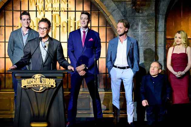 The actors onstage with the president of Universal Studios Hollywood, Larry