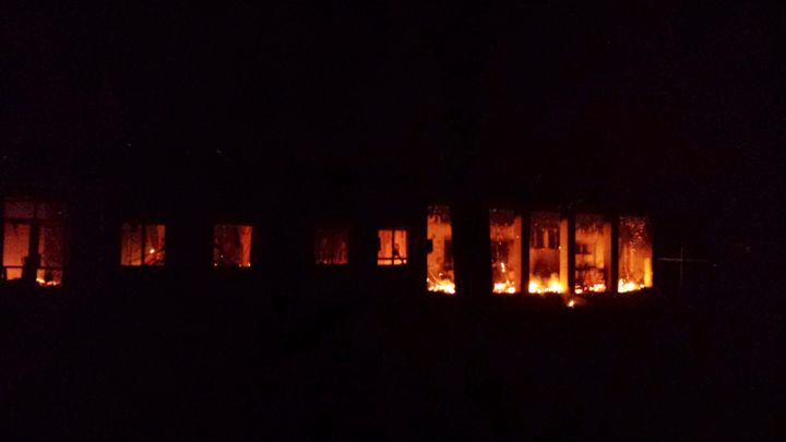"""Fire burns in the MSFhospital in Kunduz following the airstrike. Cua still remembers the """"acrid smell of smoke, the bur"""