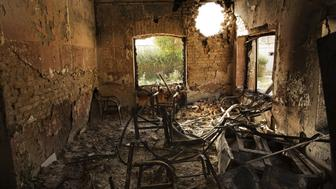An interior view of the MSF Trauma Center, October 14, 2015, shows a missile hole in the wall and the burnt-out remains of the the building after a sustained attack on the hospital in Kunduz, northern Afghanistan.
