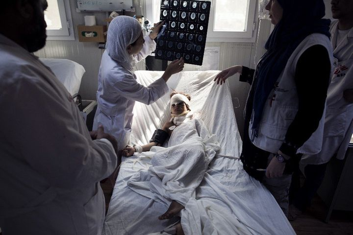The hospital was often engaged in a flurry of activity. Doctors examine a head trauma patient at the ICU in Kunduz in Sept. 2