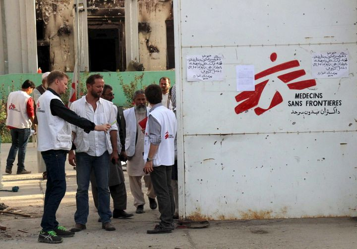 The airstrike attack killed 42 people, including 14 MSF staff members, 24 patients and four caretakers. MSF staff stand outsi