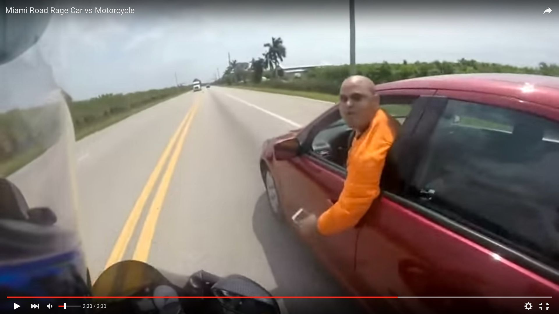 A man is seen trying to run a motorcyclist off a Florida road during a dangerous road rage battle Monday.