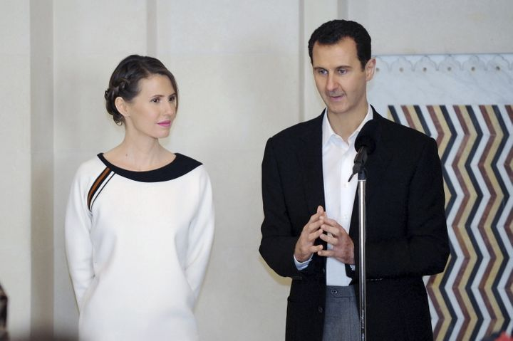 Assad and his wife Asma pictured in Damascus in March. At least 470,000 people have died in the country's ongoing w