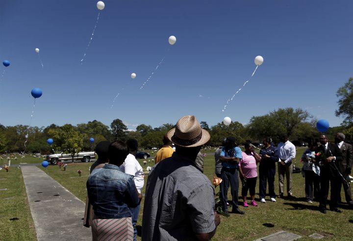 Rodney Scott (C), brother of the late Walter Scott, watches as balloons are released as relatives and friends gathered to rem