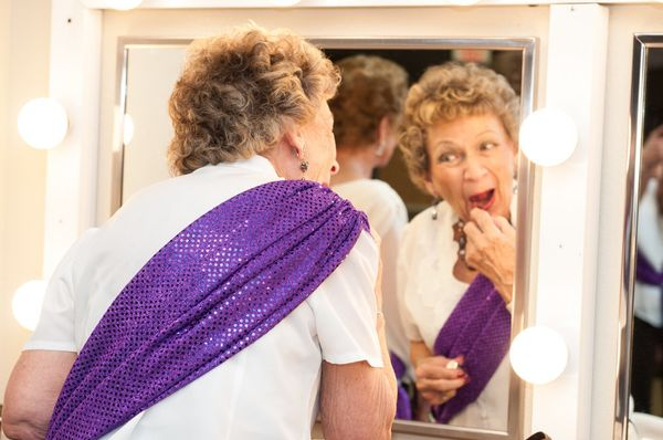 A contestant touching up her makeup backstage.