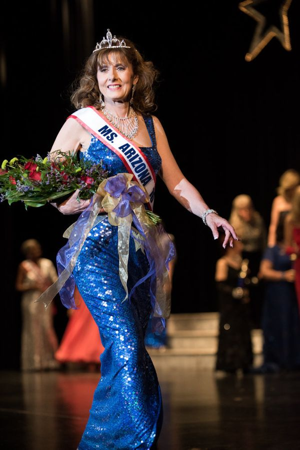 Jeanne Martin, the new Ms. Senior Arizona, walks across the stage after she is crowned.