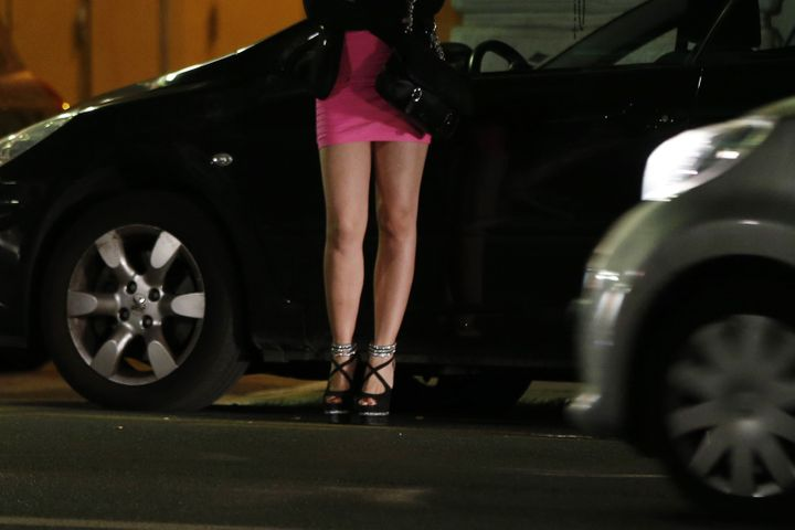A prostitute waits for clients in a street of the French southeastern city of Nice, on September 5, 2015. AFP PHOTO / VALERY