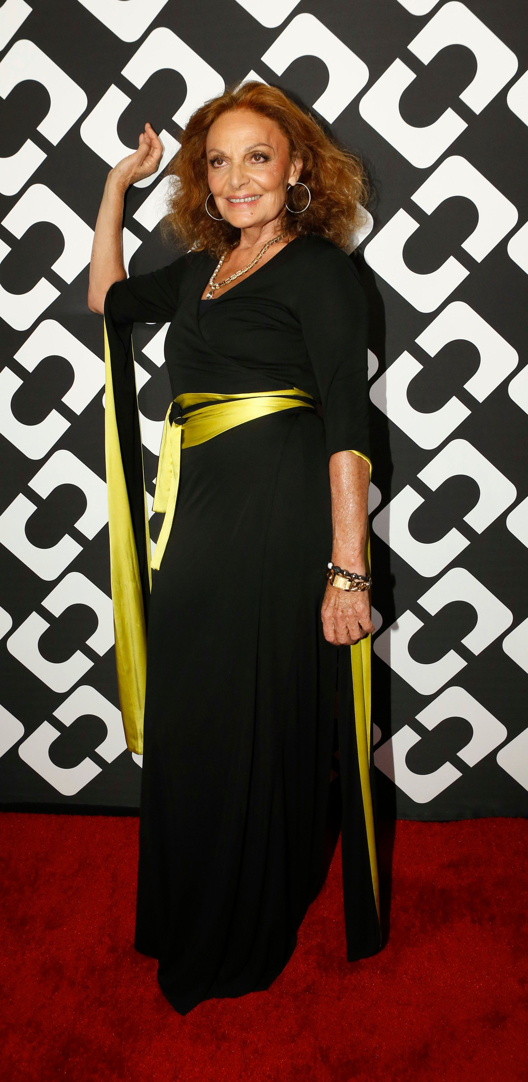 Fashion designer Diane Von Furstenberg poses at the opening of the Journey of a Dress exhibition in Los Angeles, California January 10, 2014.   REUTERS/Mario Anzuoni  (UNITED STATES - Tags: ENTERTAINMENT FASHION)