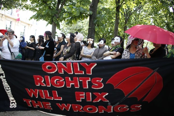 Sex workers take part in a demonstration called by the Strass union and the Roses d'Acier association on June 11, 2015 on the