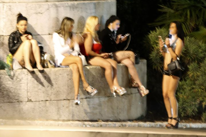 Prostitutes wait for clients in a street of the French southeastern city of Nice, on September 5, 2015. AFP PHOTO / VALERY HA