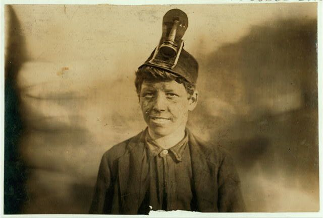 This 1906 photo shows Frank, a 14-year-old boy whoworked in a mine helping his father pick and load coal for three year