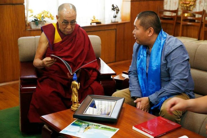 The Dalai Lama and M.BATAA, a member of the project's board of trustees and former Tibetan Buddhist monk, discuss p