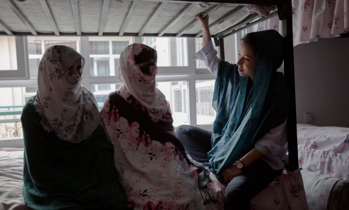 VICE correspondent Isobel Yeung speaks with two sisters-in-law at a women's shelter in Afghanistan who fled their abusive fam