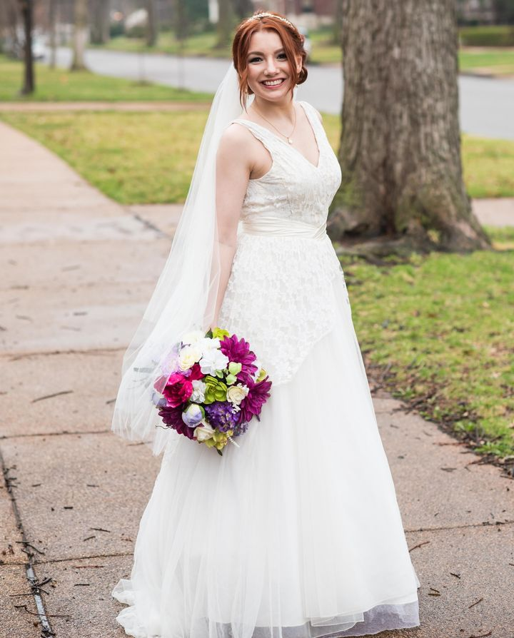 Bride Julia Cain wears the dress both her mother and grandmother previously worefor their weddings.