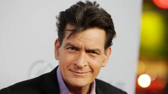 "Cast member Charlie Sheen poses at the premiere of his new film ""Scary Movie 5"" in Hollywood April 11, 2013. REUTERS/Fred Prouser  (UNITED STATES - Tags: ENTERTAINMENT PROFILE)"